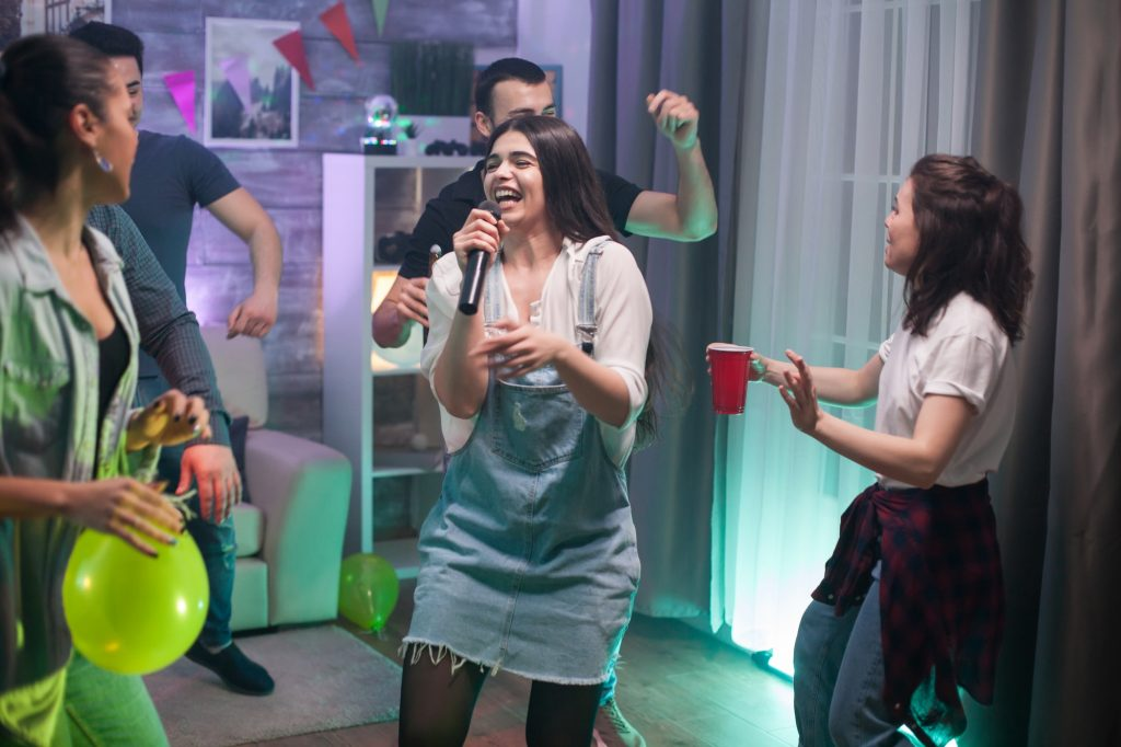 Group of friends singing together at the party